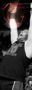 Kevin Owens raises the Universal Title high in the air.