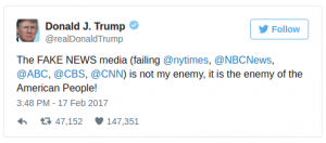 "Donald Trump tweeting that the ""fake news"" media is the enemy of the American People."